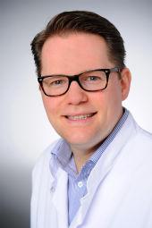 Dr. Christian Houbois