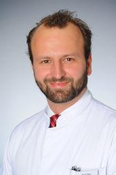 Dr. Dominik Ratiu