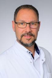 Dr. Dirk Schedler