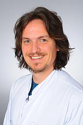 Dr. Till Dembek