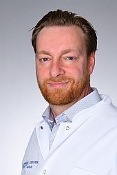 Dr. Henning Carstens